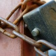 The hinged lock with a chain — Stock Photo