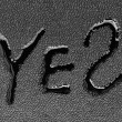 "The word ""YES"" on a black background — Stock Photo"