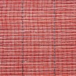Texture of a red straw mat — Stock Photo #36996245