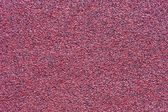 Granular texture of an abrasive material — Stock Photo