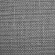 Gray background of rough dense fabric — Stock Photo