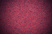 Coarse-grained red abrasive material — Stock Photo