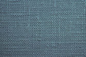 Azure background of rough dense fabric — Stock Photo