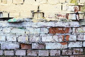 The old painted and destroyed brick walls — Stock Photo