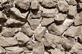 Wall from a stone of monochrome tone sepia — Stock Photo