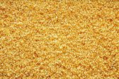 Crystal texture from minerals of yellow color — ストック写真