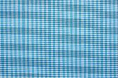 Checkered fabric of blue and white color — Stock Photo