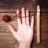 Crochet in woman hand — Stock Photo