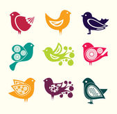 Set of cartoon doodle birds icons — Stock Vector