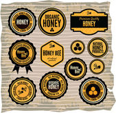 Set of honey and bee labels — Stock Vector
