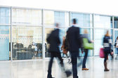 Businesspeople Rushing through Corridor, Motion Blur — Stock Photo