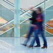 Motion Blurred People in Front of Escalator — Stock Photo
