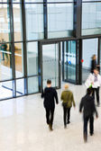 Unrecognizable People Walking in Modern Corridor, Motion Blur — Stock Photo