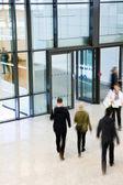 Unrecognizable People Walking in Modern Corridor, Motion Blur — Stock Photo