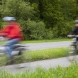 Active family riding bicycle in spring — Stock Photo