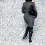 Businesswoman Walking Up Stairs, Motion Blur — Stock Photo