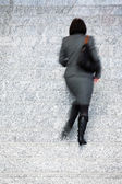 Businesswoman Walking Up Stairs, Motion Blur — Stockfoto