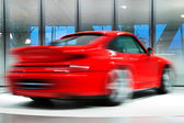 Red Sports Car on Rotating Platform — Stockfoto