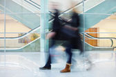 Intentional Blurred Image of Two Businesspeople in Office Buildi — Stock Photo