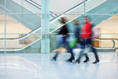 Intentional Blurred Image of Young People in Office Building — Stock Photo