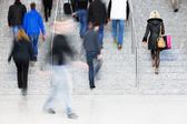 Motion Blur of People Walking on Stairs — Stock Photo