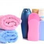 Butylki cosmetics and bath towels — Stock Photo #24084773