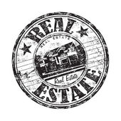 Real estate grunge rubber stamp — Stock Vector