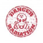 Danger radiation rubber stamp — Stock Vector