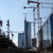 Construction site with many cranes at work — Stock Photo