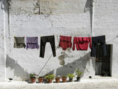 Old houses of Matera (Italy) with clothes hanging — Stock Photo