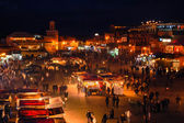 Night busy market square Djemaa El Fna in Marrakesh, Morocco. — Stock Photo
