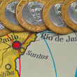 Brazil's currency on the map of Brazil — Stock Photo