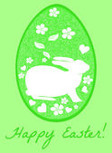 Easter egg with the bunny silhouette on a green background. Vector — Stok Vektör