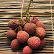 Lychee fruit on  mat — Stock Photo