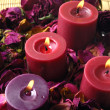 Stock Photo: Candles with red rose petals