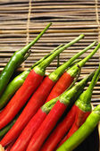 Red and green chili peppers — Stock Photo
