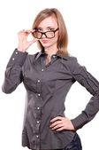 Jong meisje met een bril op een witte achtergrond — Stockfoto