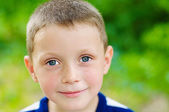 Little boy in the park smilling — Stock Photo