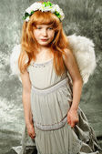 Little girl with wings on their backs — Stock Photo