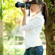 Royalty-Free Stock Photo: Girl taking photo with camera