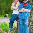 Little boy and girl in the park — Stockfoto