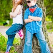 Little boy and girl in the park — Foto de Stock