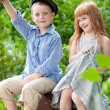 Little boy and girl in the park - Stockfoto