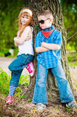 Little boy and girl in the park — Stok fotoğraf
