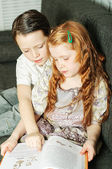 Boy and girl reading book — Stock Photo