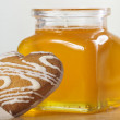 Heart-shaped cookies and a jar of honey - Stock Photo