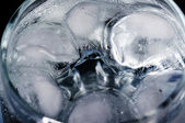 Glass of water with ice — Stock Photo