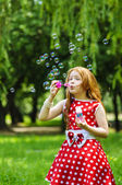 Beautiful dress girl with soap bubbles — Stock Photo