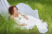 Young pregnant woman in white dress — Stock Photo