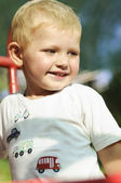 Child walking in the park with a toy — Stock Photo